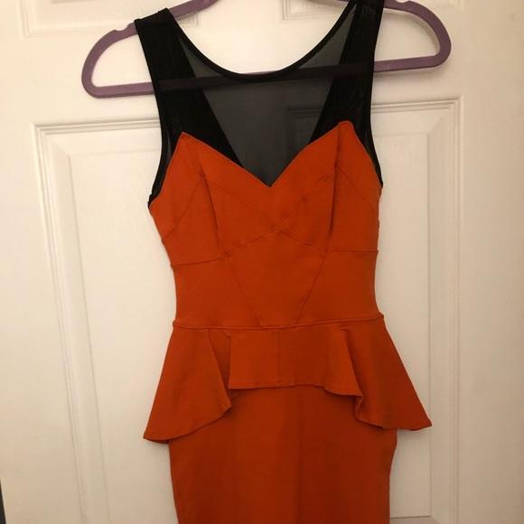 bebe Dresses & Skirts - Bebe peplum orange dress